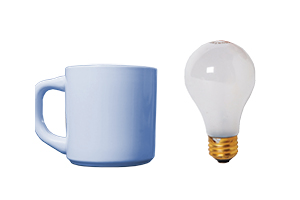 a lightbulb and a ceramic mug