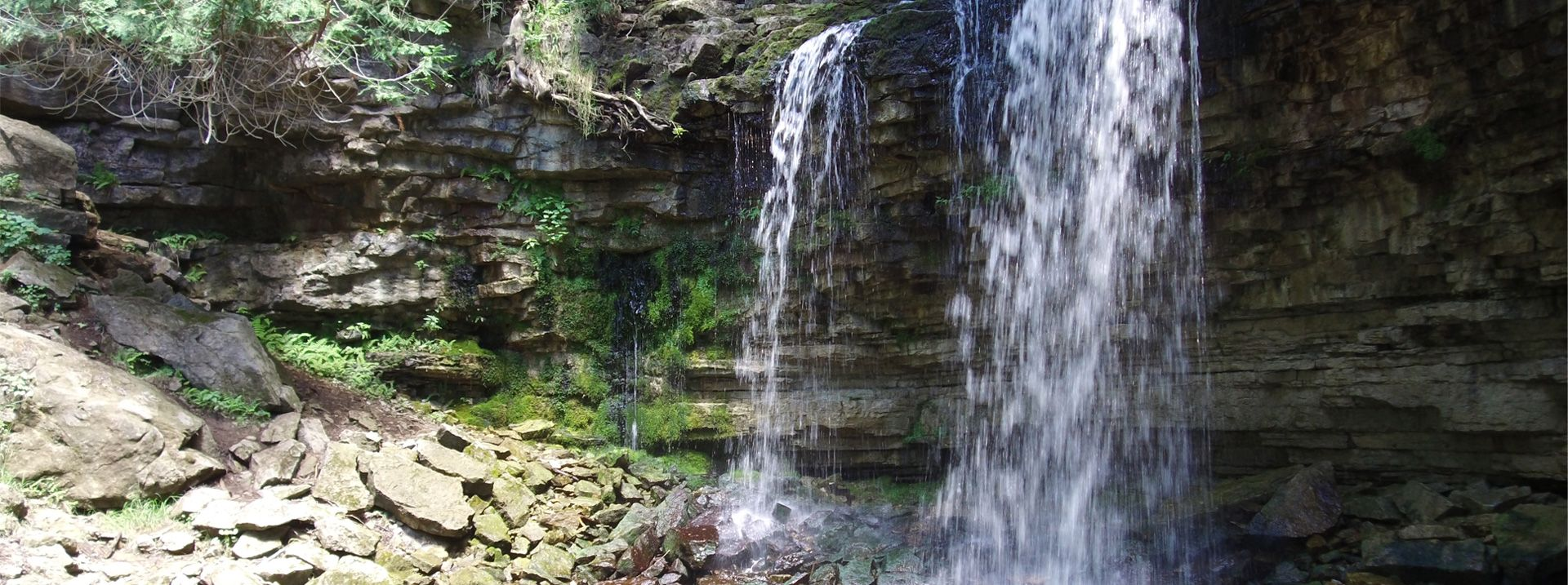 An image of a waterfall repreenting natural heritage.