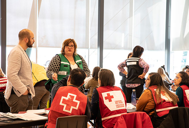 Photo of Halton Region Children Services Supervisor and Canadian Red Cross volunteers.